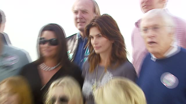 laird hamilton ted danson pierce brosnan keely shaye smith james keach cindy crawford dick van dyke david chokachi jane seymour daryl hannah and... - keely shaye smith and pierce brosnan stock videos & royalty-free footage