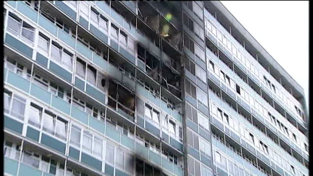 council construction manager gives evidence t04070901 / burnt out smashed windows of flats zoom in - inquest stock videos & royalty-free footage