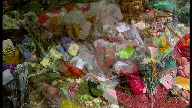 deaths 'could have been prevented' cutaways camberwell sceaux gardens estate flowers and soft toys left as a tribute to the victims of the fire - inquest stock videos & royalty-free footage
