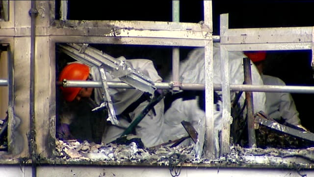 deaths 'could have been prevented' camberwell sceaux gardens estate fire investigators working in the remains of flat destroyed by the fire fire... - inquest stock videos & royalty-free footage