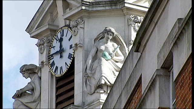 government advisor on fire and rescue policy gives evidence brixton clock and statues on top of lambeth town hall 'assembly hall' sign - lambeth stock videos & royalty-free footage