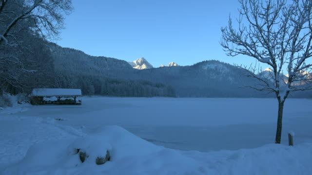 lake alpsee in schwangau near fuessen, swabia, bavaria, germany - frozen stock videos and b-roll footage