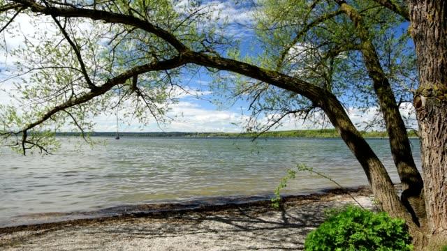 lake ammersee in spring, inning stegen, fuenfseenland, upper bavaria, bavaria, germany - inning stock videos & royalty-free footage