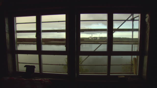 ws lake and biomass plant seen through large windows / vaxjo, sweden - vaxjo stock videos & royalty-free footage