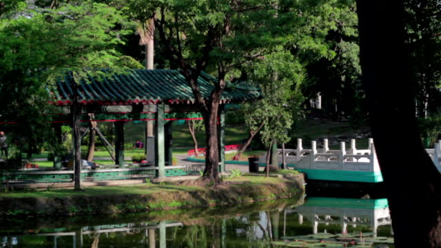 lake at chinese garden luneta philippines - classical chinese garden stock videos & royalty-free footage