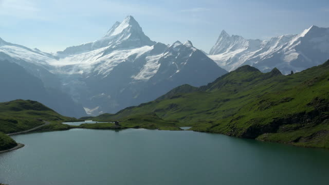 lake bachalpsee at first and bernese alps, grindelwald, bernese alps, switzerland - bernese alps stock videos & royalty-free footage
