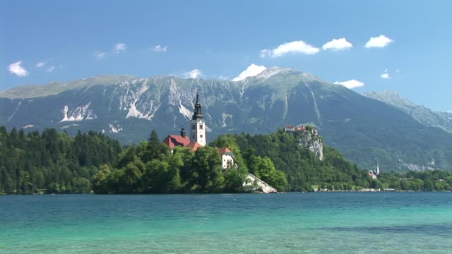 ws, zi, lake bled and island with assumption of mary church, slovenia - lago di bled video stock e b–roll