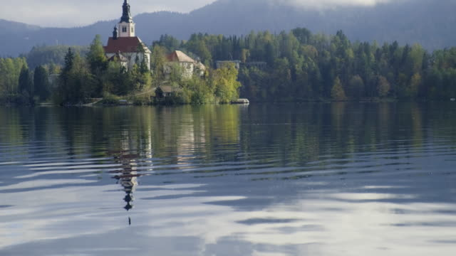 lake bled by autumn - lake bled stock videos & royalty-free footage