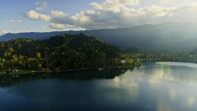 lake bled by autumn - castle island stock videos & royalty-free footage