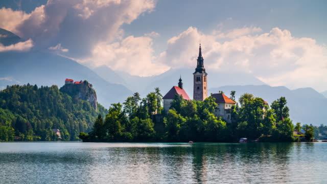 lake bled santa maria church in slovenia - castle island stock videos & royalty-free footage