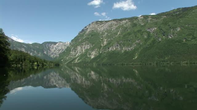 ws, lake bohinj and mountains, triglav national park, slovenia - triglav national park stock videos and b-roll footage