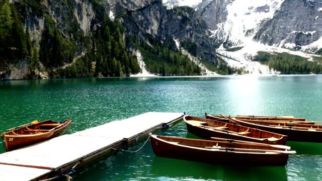lake braies 4k - dolomites stock videos & royalty-free footage