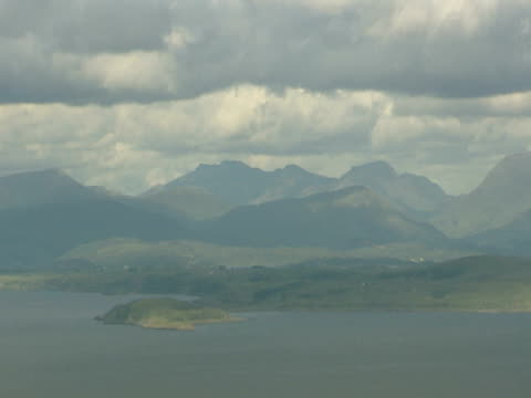 vidéos et rushes de lake by mountains, cloudy, calm tranquil, peaceful, idyllic, picture postcard - mull