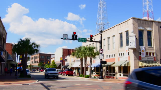 Lake Charles Louisiana Ryan St and Broad St downtown traffic intersection in busy small town