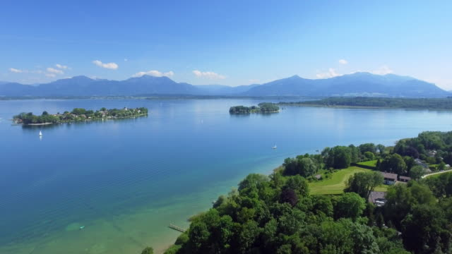 lake chiemsee and the fraueninsel in upper bavaria - german culture stock videos and b-roll footage