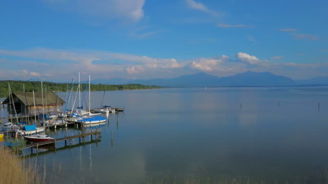 stockvideo's en b-roll-footage met lake chiemsee near seebruck, chiemgau, upper bavaria, bavaria, germany - aangelegd