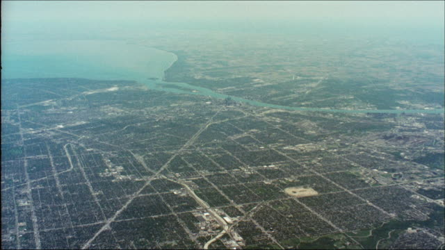 lake erie and the detroit river separate detroit from windsor in southern ontario. - lago erie video stock e b–roll