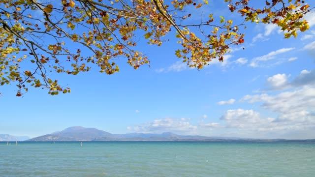 lake garda in autumn, sirmione, brescia, lake garda, lago di garda, lombardy, lombardei, italy - lago stock videos & royalty-free footage