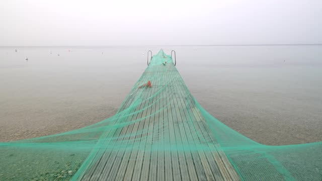 Lake Garda with wooden jetty at dawn, Garda, Lake garda, Lago di Garda, Veneto, Italy
