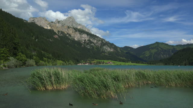 Lake Haldensee with the Village of Haldensee near Graen against Rote Flueh (2108m), Tyrol, Austria