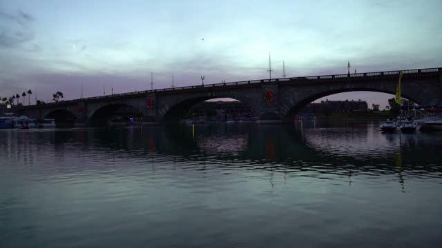 lake havasu at dawn london bridge relocation america - bridge built structure stock videos & royalty-free footage