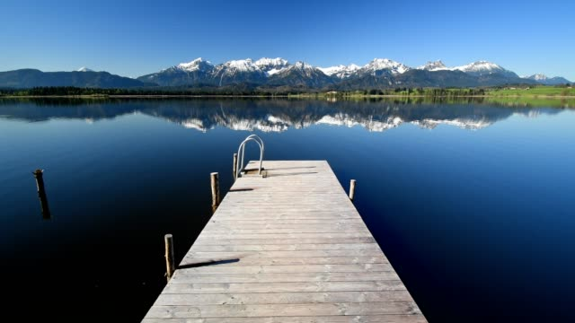 lake hope with wooden jetty, hopfen am see, allgau, bavaria, germany - jetty stock videos & royalty-free footage