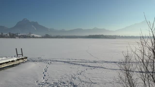 lake hopfensee, hopfen am see near fuessen in the allgaeu, swabia, bavaria, germany - frozen stock videos and b-roll footage