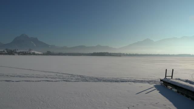 lake hopfensee in winter, hopfen am see near fuessen in the allgaeu, swabia, bavaria, germany - frozen stock videos and b-roll footage