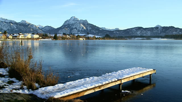 WS Lake Hopfensee with city and mountain near Fussen / Hopfen am See, Bavaria, Germany