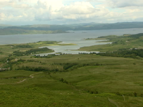 vidéos et rushes de lake in distance, surrounded by land, woodland, scrub, picture postcard, idyllic, tranquil - mull