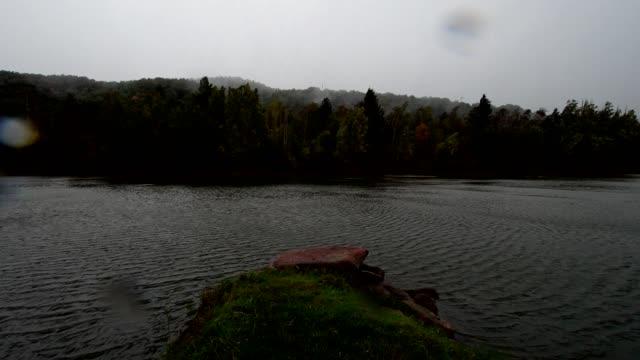 Lake in storm and rain in autumn, Mondfeld, Wertheim, Main-Tauber-Kreis, Baden-Württemberg, Germany