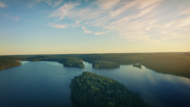 lake in sweden flyover - svezia video stock e b–roll