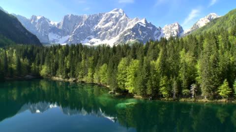 ws aerial lake laghi di fusine with mt mangart - natural landmark stock videos & royalty-free footage