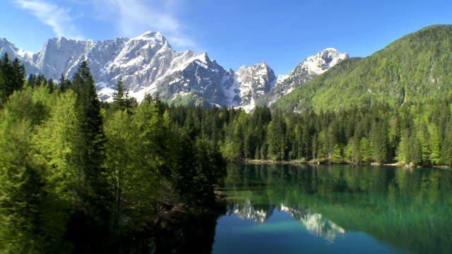 ws aerial lake lago di fusine with mt mangart - natural landmark stock videos & royalty-free footage