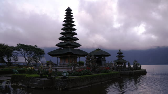 lake landscape on morning at pura ulun danu bratan temple,one of famous tourist attraction in bali, indonesia - pura ulu danau temple stock videos & royalty-free footage
