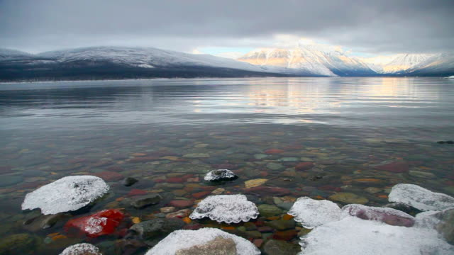 ws lake mcdonald on winter evening, glacier national park, montana, usa - glacier national park us stock videos and b-roll footage