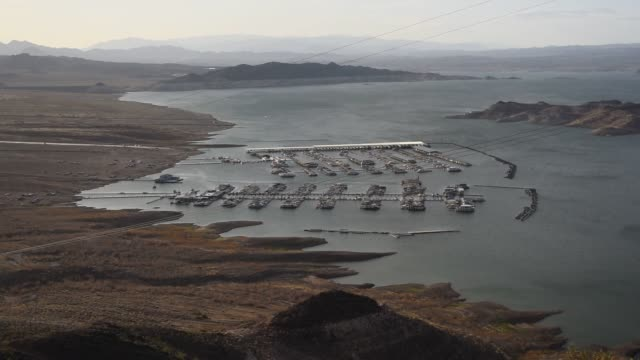 Lake Mead stands in Boulder City Nevada US on Thursday June 4 2015 Shots Wide shots look down at marina activity on Lake Mead at sunset Beautiful...