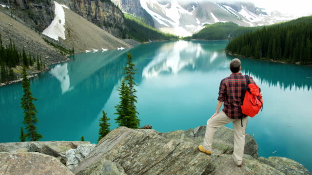 lake moraine male hiker banff national park canada - red lake stock videos & royalty-free footage