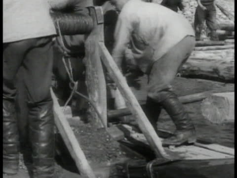 lake mountains miners panning for gold fisherman rowing together in boat throwing nets - 1935 stock videos & royalty-free footage