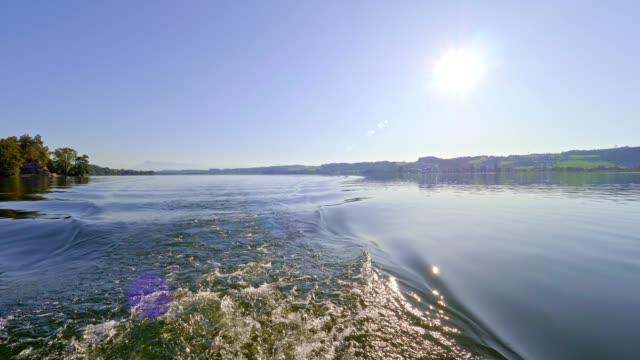 vídeos y material grabado en eventos de stock de lago obertrumer see, austria, en verano - deporte acuático