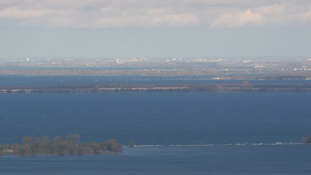 lake ontario with canada and distant ottawa - ontario kanada stock-videos und b-roll-filmmaterial