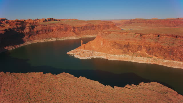 aerial lake powell and a spire on the river bank - lake powell stock videos & royalty-free footage