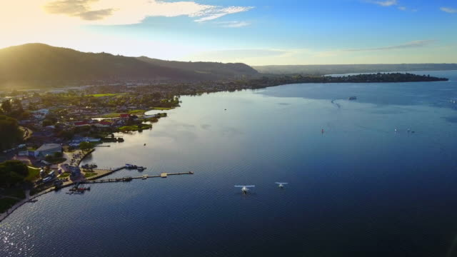 lake rotorua is the second largest lake on new zealand's south island. sea planes rest on the lake at sunset. - rotorua stock videos and b-roll footage