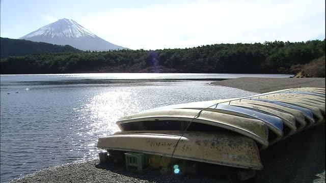 Lake Saiko stretches along a row of empty boats in the Fuji Hakone Izu National Park in Yamanashi, Japan.