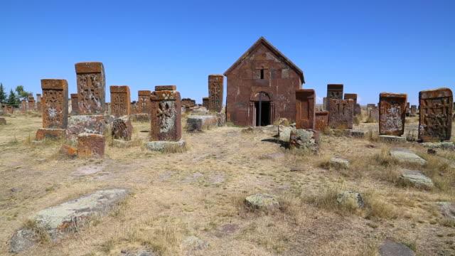 lake sevan, cross-slabs and tombs in nuraduz cemetery - eastern european culture stock videos & royalty-free footage