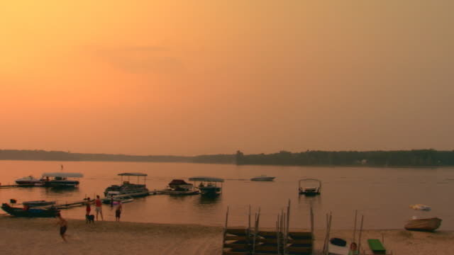 lake shore at sunset, jib shot - jib shot stock videos & royalty-free footage