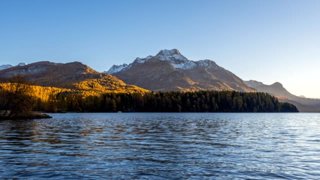 Lake Silsersee in autumn at sunset, Sils im Engadin, Engadin, Grisons, Switzerland, European Alps