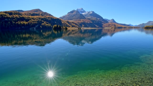 lake silsersee in autumn, sils im engadin, engadin, grisons, switzerland, european alps - alps stock videos and b-roll footage
