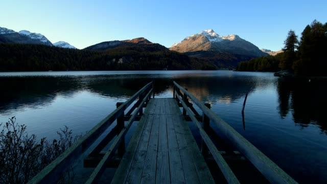Lake Silsersee with wooden jetty at morning in autumn, Sils im Engadin, Engadin, Grisons, Switzerland, European Alps