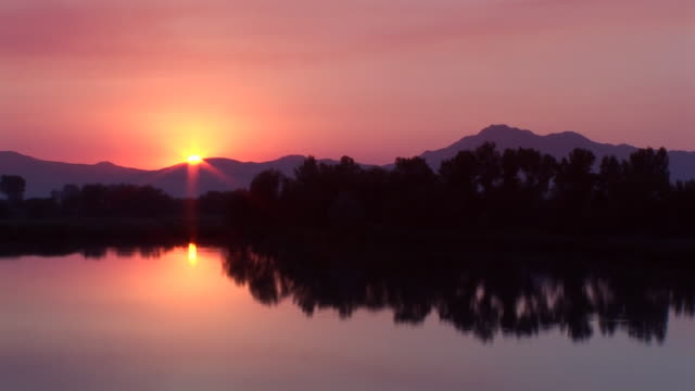 lake sunset - tranquil scene stock videos & royalty-free footage